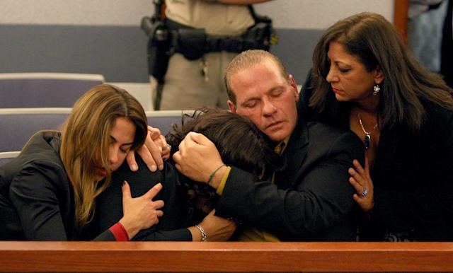 <p>O.J. Simpson, supporters Sabrina Scotto, sister, Carmelita Durio, Tom Scotto, and Sandra Scotto react as he Simpson is found guilty on all 12 charges, including felony kidnapping, armed robbery and conspiracy at the Clark County Regional Justice Center in Las Vegas, Nev., on Friday, Oct. 3, 2008. The verdict comes thirteen years to the day after he was acquitted of double murder charges. (Photo: Daniel Gluskoter, Pool/AP) </p>