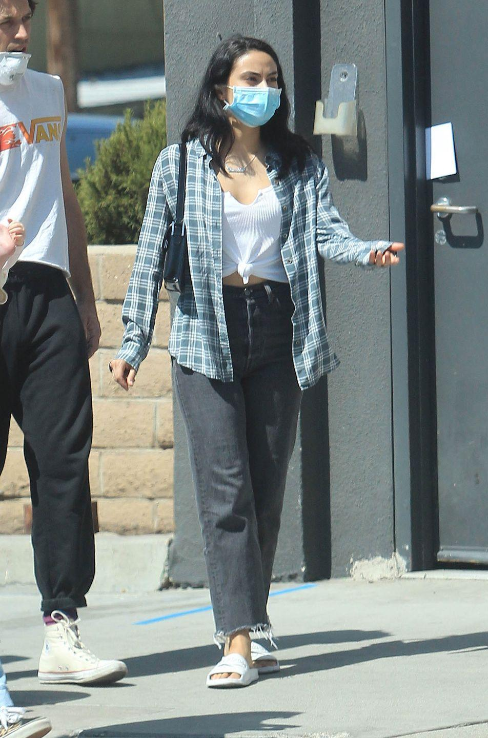 <p>Realistically, any outfit you pick for the first day of school is going to look at lot like this. Camila's flannel/tank/mask look is the ultimate chill feel.</p>