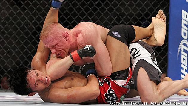 Dennis Siver lands an elbow on Nam Phan during their fight at UFC on Fox 5. (Credit: Tracy Lee for Yahoo! Sports)