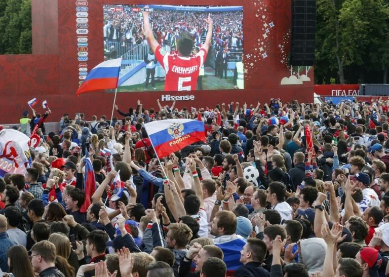 Russian fans mingled with supporters from overseas to watch the World Cup opener in a fanzone in Moscow