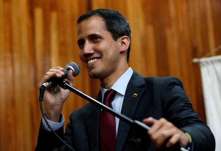 FILE PHOTO: Venezuelan opposition leader Juan Guaido speaks during a meeting with representatives of FEDEAGRO, the Confederation of Associations of Agricultural Producers of Venezuela, in Caracas, Venezuela February 6, 2019. REUTERS/Carlos Garcia Rawlins/File Photo