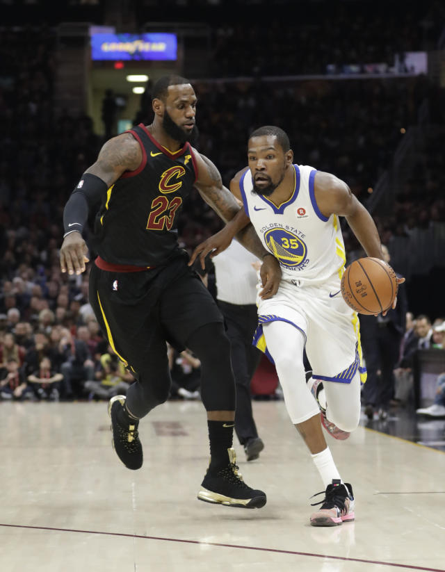 <p> Golden State Warriors' Kevin Durant goes to the basket against Cleveland Cavaliers' LeBron James during the first half of Game 4 of basketball's NBA Finals, Friday, June 8, 2018, in Cleveland. (AP Photo/Tony Dejak) </p>