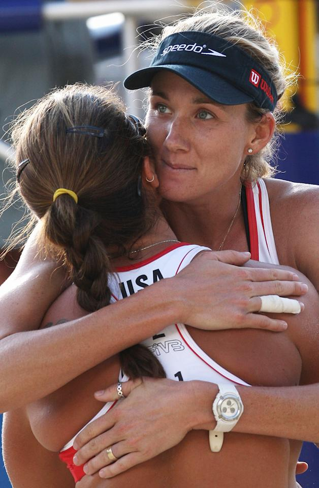 Kerri Walsh of USA hugs team mate Misty May-Treanor after their win during day two of the FIVB 2007 Beach Volleyball World Championships on July 25, 2007 in Gstaad, Switzerland.