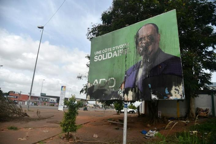 Anger: A poster of President Alassane Ouattara after clashes in Yamoussoukro following the October 31 elections