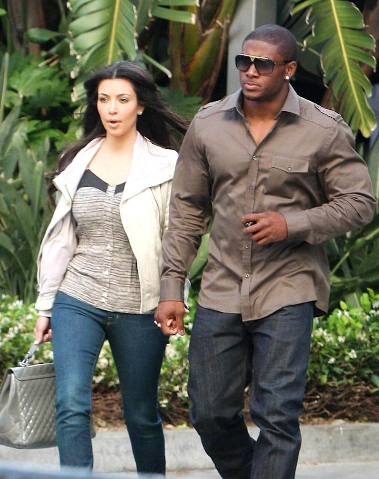 "Kim Kardashian, who just launched her own shoe-shopping service, holds on tight to boyfriend Reggie Bush. Miguel Aguilar/<a href=""http://www.infdaily.com"" target=""new"">INFDaily.com</a> - May 27, 2009"