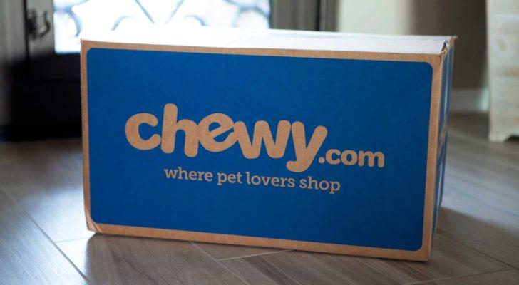 Image of a Chewy (CHWY) branded delivery box in the middle of a well-lit living room.