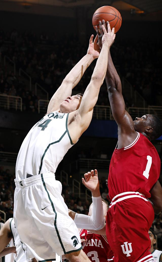 Michigan State's Gavin Schilling, left, and Indiana's Noah Vonleh (1) reach for a rebound during the first half of an NCAA college basketball game, Tuesday, Jan. 21, 2014, in East Lansing, Mich. Michigan State won 71-66. (AP Photo/Al Goldis)