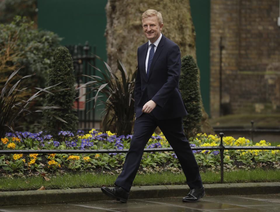 British lawmaker Oliver Dowden, the Paymaster General and Minister for the Cabinet Office arrives at 10 Downing Street in London, Thursday, Feb. 13, 2020. British Prime Minister Boris Johnson shook up his government on Thursday, firing and appointing ministers to key Cabinet posts. Johnson was aiming to tighten his grip on government after winning a big parliamentary majority in December's election. That victory allowed Johnson to take Britain out of the European Union in January. (AP Photo/Matt Dunham)