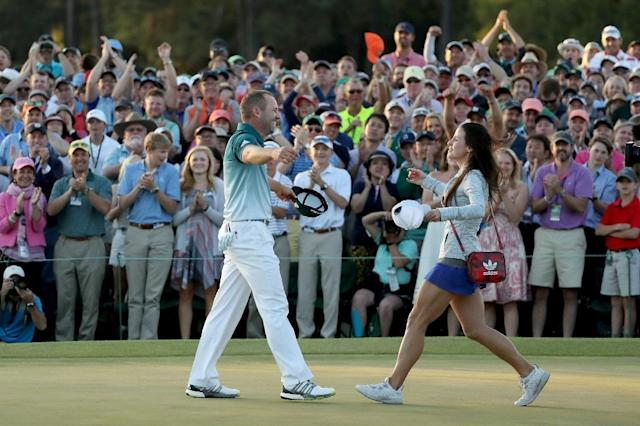 Sergio Garcia embraces fiancee Angela Akins in celebration after defeating Justin Rose on the first playoff hole during the final round of the 2017 Masters Tournament, at Augusta National Golf Club in Georgia, on April 9 (AFP Photo/David Cannon)