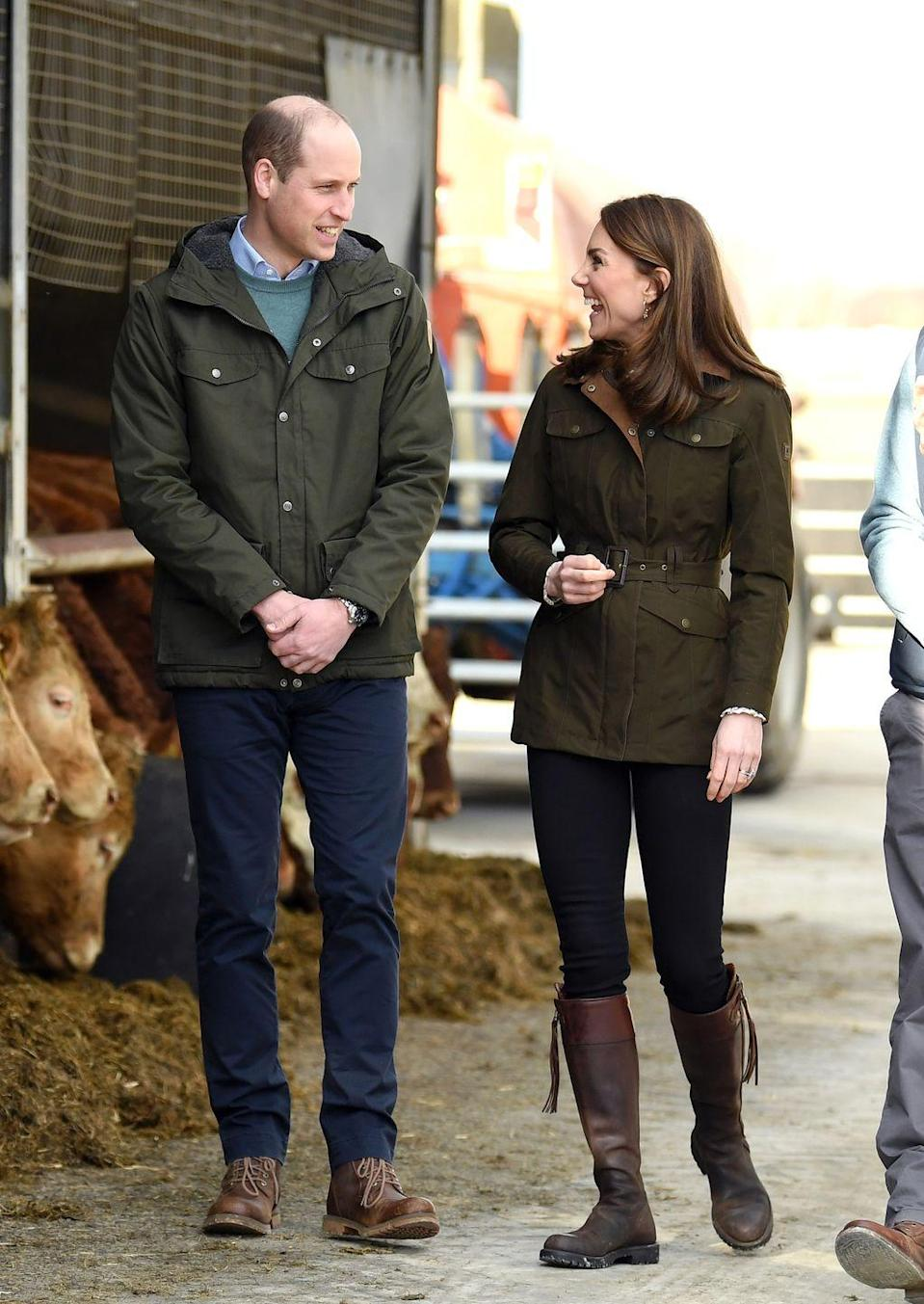 "<p>For Kate's second outfit of the day, she put on something a bit more comfortable and durable. To visit Teagasc Research Farm in County Meath, Ireland, Kate swapped out her top and shoes, wearing a <a href=""https://www.dubarry.com/us/women/clothing/jackets-vests/friel-utility-jacket-olive?c=42"" rel=""nofollow noopener"" target=""_blank"" data-ylk=""slk:Dubarry of Ireland belted, waxed jacket"" class=""link rapid-noclick-resp"">Dubarry of Ireland belted, waxed jacket</a> and some of her <a href=""https://www.penelopechilvers.com/us/long-tassel-boot-conker.html"" rel=""nofollow noopener"" target=""_blank"" data-ylk=""slk:favorite riding boots"" class=""link rapid-noclick-resp"">favorite riding boots</a>. </p>"