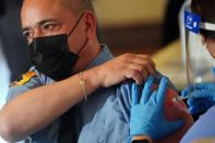 Workers of the FDNY EMS receive COVID-19 Moderna vaccine in New York