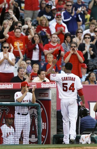 Los Angeles Angels starting pitcher Ervin Santana waves as he leaves the baseball game against the Oakland Athletics during the eighth inning in Anaheim, Calif., Tuesday, May 15, 2012. (AP Photo/Chris Carlson)