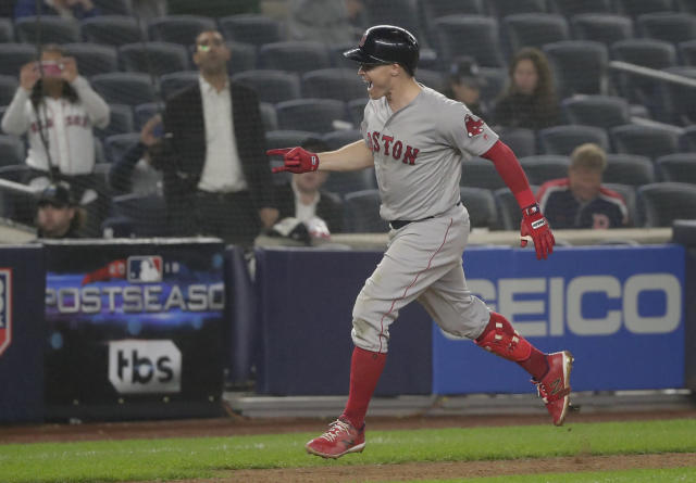 The Red Sox's Brock Holt rounds the bases after hitting a two-run home run against the Yankees during the ninth inning Monday night. (AP)