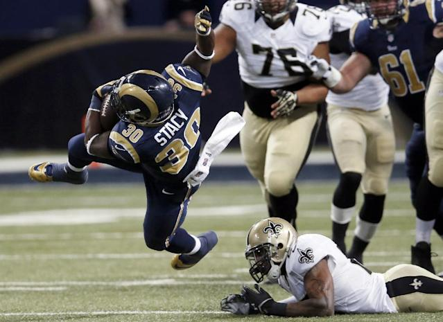 St. Louis Rams running back Zac Stacy, left, goes flying after being hit by New Orleans Saints safety Malcolm Jenkins, right, during the first quarter of an NFL football game Sunday, Dec. 15, 2013, in St. Louis. (AP Photo/Charles Rex Arbogast)