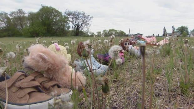 Children's shoes, stuffed animals and other objects were placed this week on the field where Saskatchewan's St. Michael's Indian Residential School once stood in Duck Lake. (Chanss Lagaden/CBC - image credit)