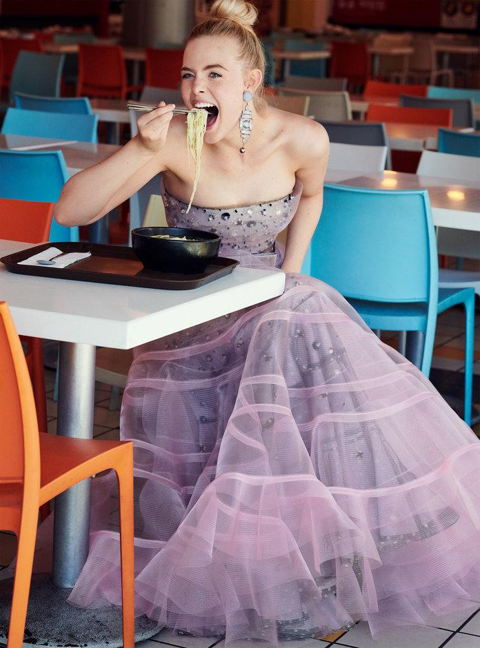 <p>Fanning in Armani Privé dress and earrings. Photographed by Pamela Hanson/LGA Management.</p>