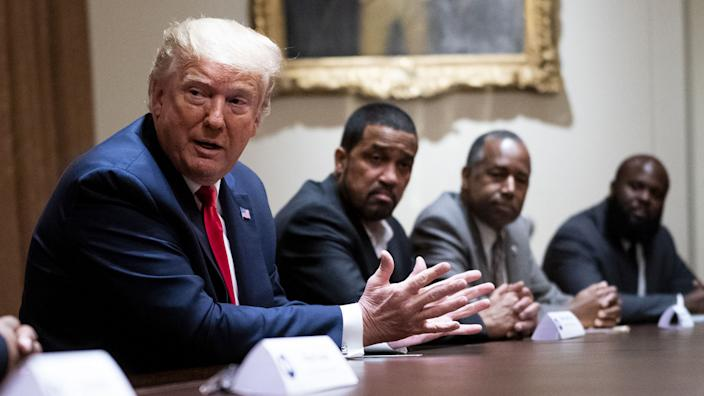 U.S. President Donald Trump, center, speaks during a meeting with African-American supporters in the Cabinet Room of the White House in Washington, D.C., U.S., on Wednesday, June 10, 2020. (Doug Mills/The New York Times/Bloomberg via Getty Images)