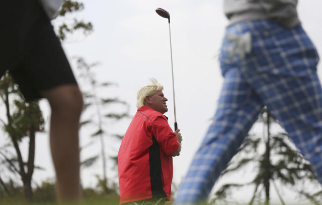 John Daly of the U.S. looks at his tee shot at the 8th hole during the second round of the BMW Masters golf tournament at the Lake Malaren Golf Club in Shanghai, China, Friday, Oct. 25, 2013. (AP Photo/Eugene Hoshiko)