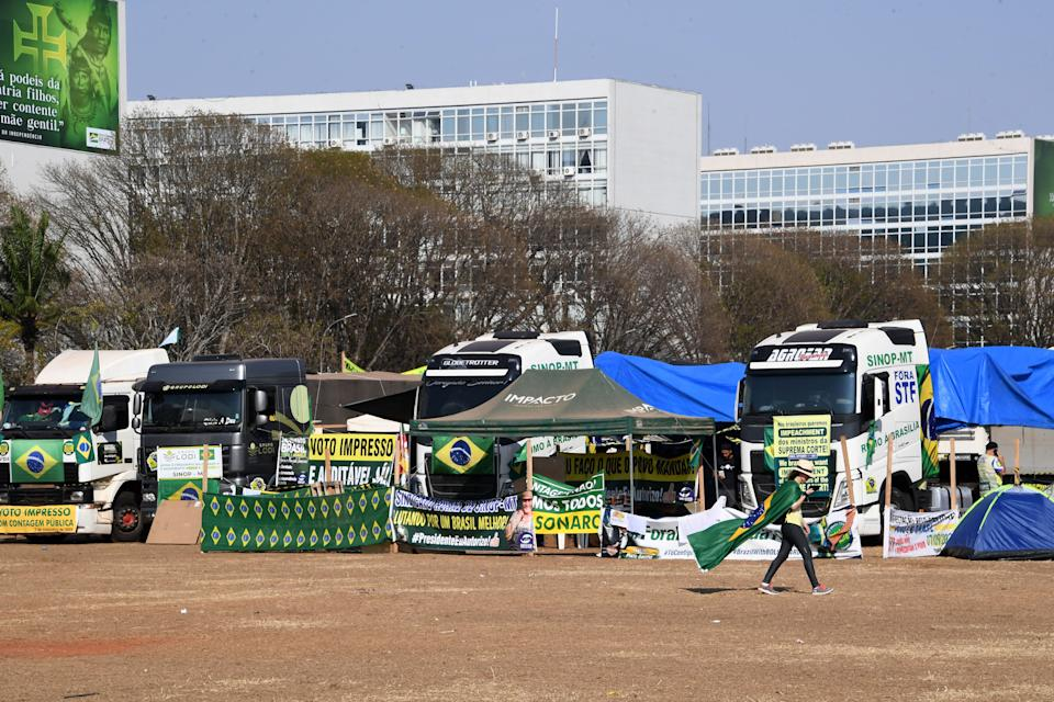 Trucks occupy the Esplanada dos Ministerios in support of the government of Brazilian President Jair Bolsonaro in Brasilia, on September 9, 2021. - Truck drivers blocked highways across Brazil Thursday in support of President Jair Bolsonaro, who has sought to fire up his far-right base as he fights sinking poll numbers and a supposedly hostile political establishment. (Photo by EVARISTO SA / AFP) (Photo by EVARISTO SA/AFP via Getty Images)