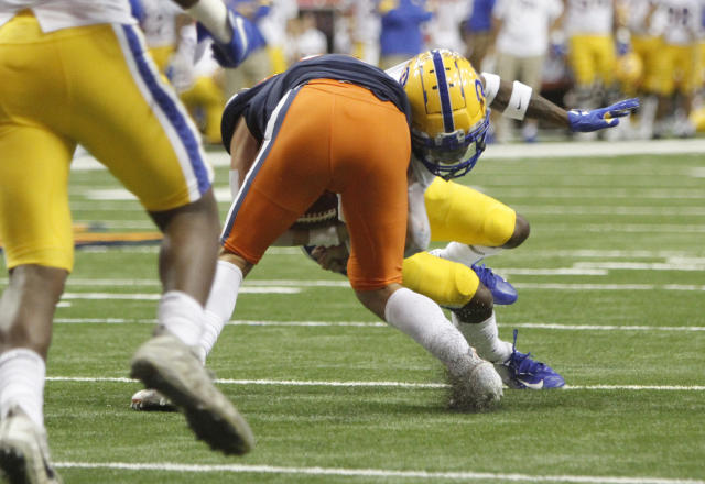 Pittsburgh's Paris Ford, right, hits Syracuse's Tommy DeVito during the third quarter of an NCAA college football game in Syracuse, N.Y., Friday, Oct. 18, 2019. DeVito was injured on the play and did not return to he game. Pittsburgh won 27-20. (AP Photo/Nick Lisi)