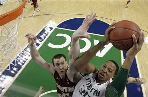 Miami's Kenny Kadji (35) shoots over Boston College's Dennis Clifford (24) during the first half of an NCAA college basketball game at the Atlantic Coast Conference tournament in Greensboro, N.C., Friday, March 15, 2013. (AP Photo/Bob Leverone)