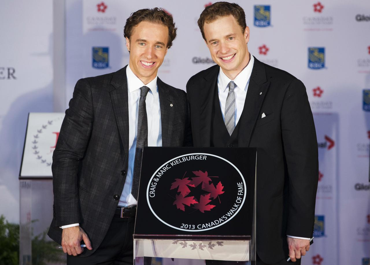 Social advocates and founders of charity Free the Children Craig (L) and Marc Kielburger pose beside their star during Canada's Walk of Fame induction ceremonies in Toronto, September 21, 2013. REUTERS/Mark Blinch (CANADA - Tags: ENTERTAINMENT SOCIETY)