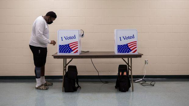 A person casts his ballot for the upcoming presidential election during early voting in Sumter, South Carolina, U.S., October 9, 2020.