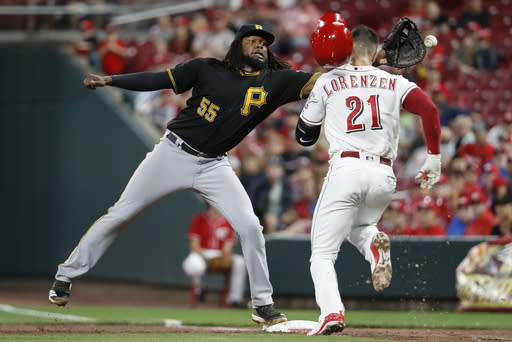 Pittsburgh Pirates first baseman Josh Bell misses the ball on the throw from starting pitcher Nick Kingham to allow Cincinnati Reds' Michael Lorenzen to reach first safely in the fifth inning of a baseball game, Saturday, July 21, 2018, in Cincinnati. Lorenzen was charged with a throwing error. (AP Photo/John Minchillo)