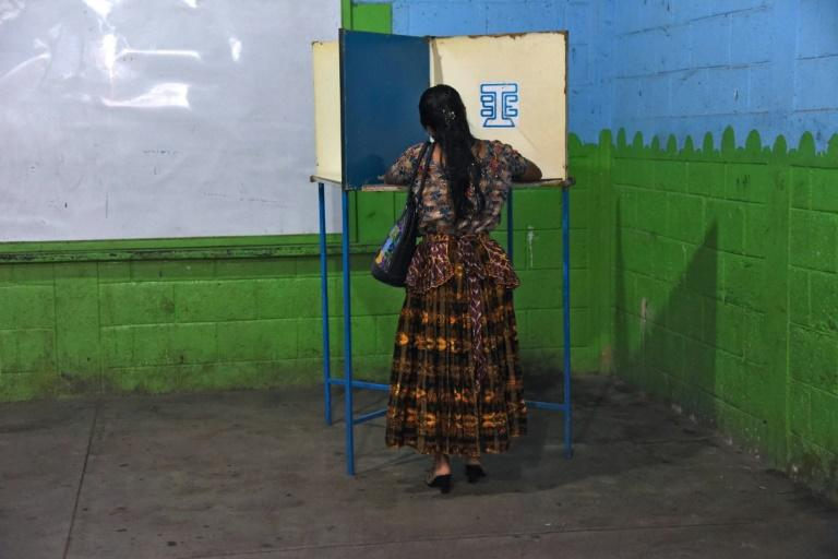 An indigenous woman votes during the run-off presidential election in Guatemala