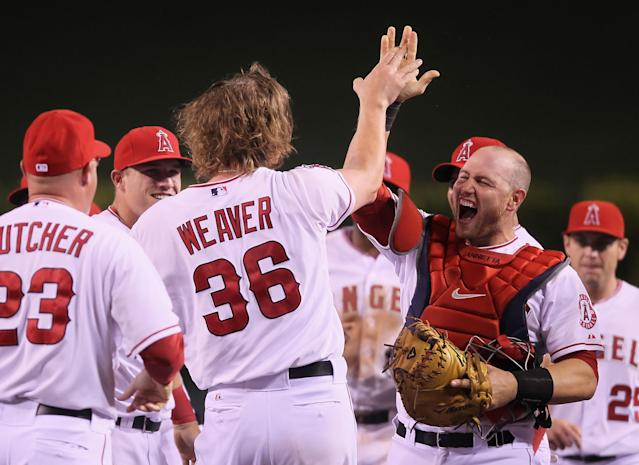 ANAHEIM, CA - MAY 02: Starting pitcher Jered Weaver #36 of the Los Angeles Angels of Anaheim celebrates with catcher Chris Iannetta (R) #17 and the rest of his teammates after throwing a no-hitter against the Minnesota Twins at Angel Stadium of Anaheim on May 2, 2012 in Anaheim, California. The Angels defeated the Twins 9-0. (Photo by Jeff Gross/Getty Images)