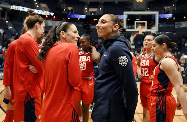 FILE - In this Jan. 27, 2020, file photo, United States' Sue Bird, left, and Diana Taurasi share a light moment at the end of an exhibition basketball game against Connecticut in Hartford, Conn. Taurasi and Bird know that they are on the tail end of their incredible basketball careers. After both stars missed last season due to injuries, skipping the 2020 season could have meant the end of their illustrious careers because it would have been difficult to return after two years off according to them. (AP Photo/Jessica Hill, File)