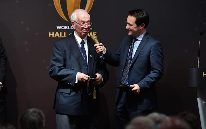 John Dawes is interviewed by Seb Lauzier at the Induction ceremony during the World Rugby via Getty Images Hall of Fame Launch - Tony Marshall - World Rugby via Getty Images/World Rugby via Getty Images