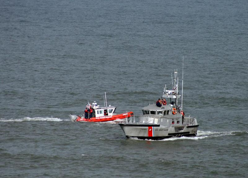 The U.S. Coast Guard and local authorities search for a a single-engine CJ-6A plane that crashed into the ocean near Ocean City, Md. on Sunday, June 30, 2013. Ocean City Mayor Rick Meehan says the pilot is presumed dead. (AP Photo/Courtesy Ed Tobias)