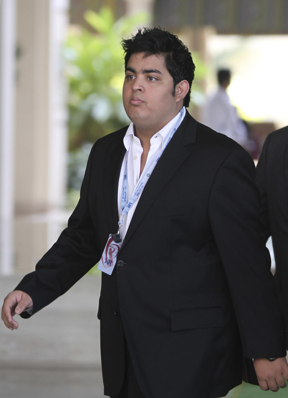 Son of Indian businessman and owner of 'Mumbai Indians' Indian Premier League (IPL) cricket team Mukesh Ambani, Akash Ambani arrives to take part in the second day of The IPL player auction in Bangalore on January 9, 2011, ahead of the fourth season of the T20 tournament. The tournament, to be held from April 8 to May 22, will feature 10 teams, including two new sides -- Pune Warriors and Kochi. AFP PHOTO/STR