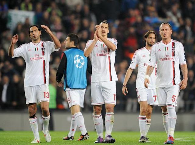AC Milan's defender Alessandro Nesta (L), AC Milan's Swedish forward Zlatan Ibrahimovic and AC Milan's French defender Philippe Mexes leave the pitch at the end of the Champions League quarter-final second leg football match FC Barcelona vs AC Milan on April 3, 2012 at Camp Nou stadium in Barcelona. FC Barcelona defeated AC Milan 3-1 to reach the semi-finals. AFP PHOTO / ALBERTO LINGRIA