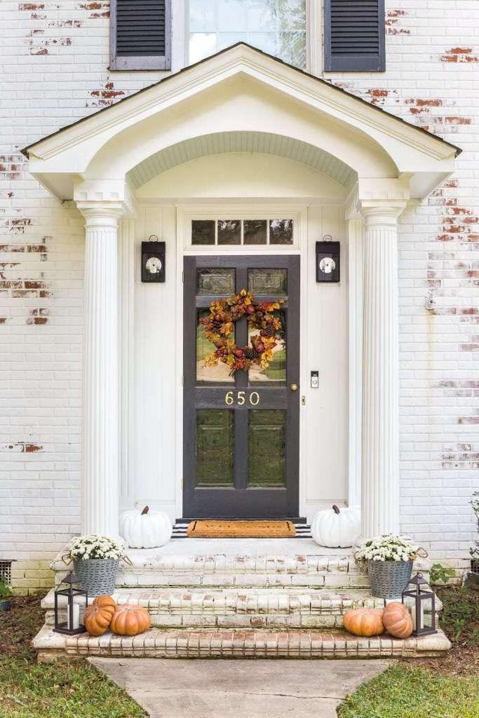 """<p>When it comes to small porches, sometimes simple reigns supreme. To make the most of your space, choose a few autumnal accents—like pumpkins, mums, and lanterns—and create a symmetric vignette on each side of your entryway. </p><p><a class=""""link rapid-noclick-resp"""" href=""""https://www.blesserhouse.com/fall-front-porch-stoop/"""" rel=""""nofollow noopener"""" target=""""_blank"""" data-ylk=""""slk:GET THE TUTORIAL"""">GET THE TUTORIAL</a></p>"""