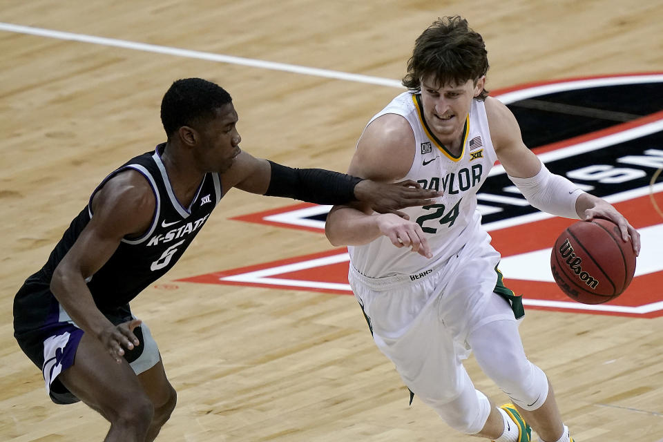 Baylor's Matthew Mayer (24) is pressured by Kansas State's Rudi Williams during the first half of an NCAA college basketball game in the second round of the Big 12 Conference tournament in Kansas City, Mo., Thursday, March 11, 2021. (AP Photo/Charlie Riedel)