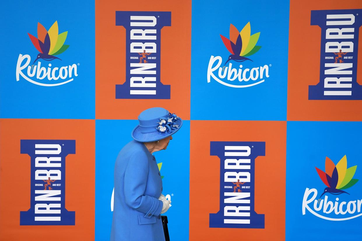 Queen Elizabeth II during a visit to AG Barr's factory in Cumbernauld, where the Irn-Bru drink is manufactured, as part of her traditional trip to Scotland for Holyrood Week. Picture date: Monday June 28, 2021.