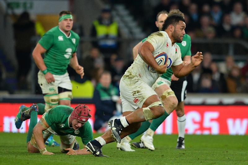 England's number 8 Billy Vunipola (R) runs with the ball during the Six Nations international rugby union match between England and Ireland at Twickenham in south west London on February 27, 2016 (AFP Photo/Glyn Kirk)