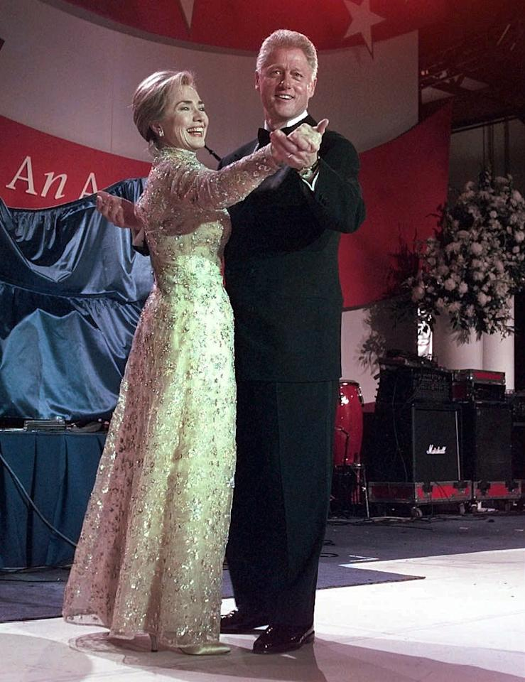 President Clinton and his wife, first lady Hillary Clinton, dance at the New England Ball Monday, Jan. 20, 1997, in Washington.  (AP Photo/J. Scott Applewhite)