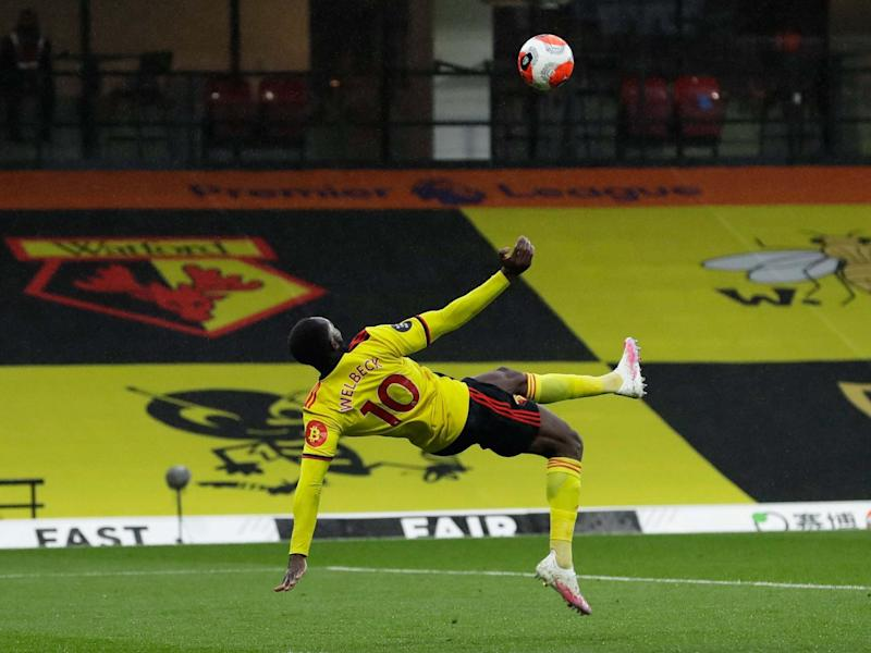 Danny Welbeck sets himself to score with an overhead kick: Getty