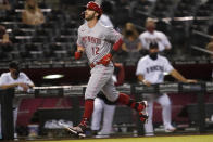 Cincinnati Reds' Tyler Naquin rounds the bas after hitting a solo home run against the Arizona Diamondbacks during the fourth inning of a baseball game, Friday, April 9, 2021, in Phoenix. (AP Photo/Matt York)