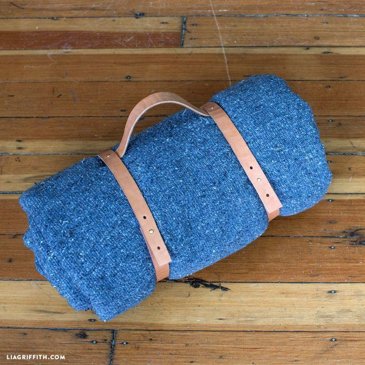 """<p>This easy DIY could do double duty as a firewood carrier. So you basically got your dad <em>two</em> gifts. </p><p><a href=""""https://go.redirectingat.com?id=74968X1596630&url=https%3A%2F%2Fliagriffith.com%2Fleather-blanket-carrier%2F%3Fsscid%3D51k3_i9gxx&sref=https%3A%2F%2Fwww.oprahdaily.com%2Flife%2Fg27603456%2Fdiy-homemade-fathers-day-gifts%2F"""" rel=""""nofollow noopener"""" target=""""_blank"""" data-ylk=""""slk:Get the tutorial."""" class=""""link rapid-noclick-resp"""">Get the tutorial.</a></p>"""