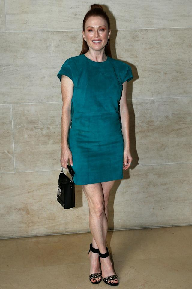 <p><strong>3 October</strong> Julianne Moore wore a teal dress with contrasting orange eyeshadow to the show.</p>