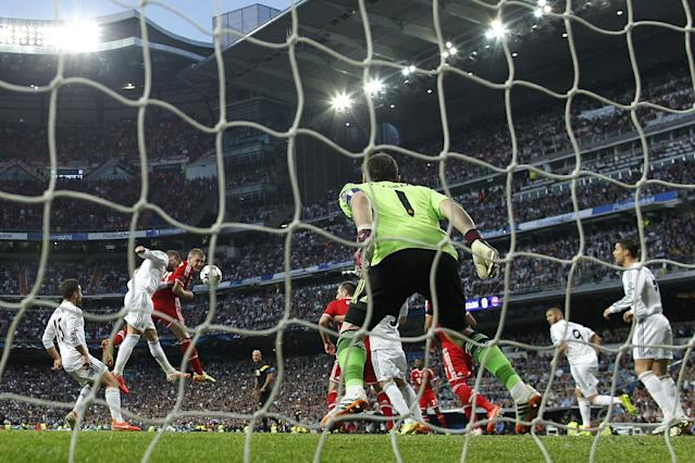 Bayern's Bastian Schweinsteiger, third left, in action with Real's Sergio Ramos, second left, during a first leg semifinal Champions League soccer match between Real Madrid and Bayern Munich at the Santiago Bernabeu stadium in Madrid, Spain, Wednesday, April 23, 2014. (AP Photo/Andres Kudacki)