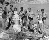 <p>Your cookouts probably don't look like this one. Back in the 1940s, young people donned their retro swimsuits and cooked beachside in Los Angeles. </p>