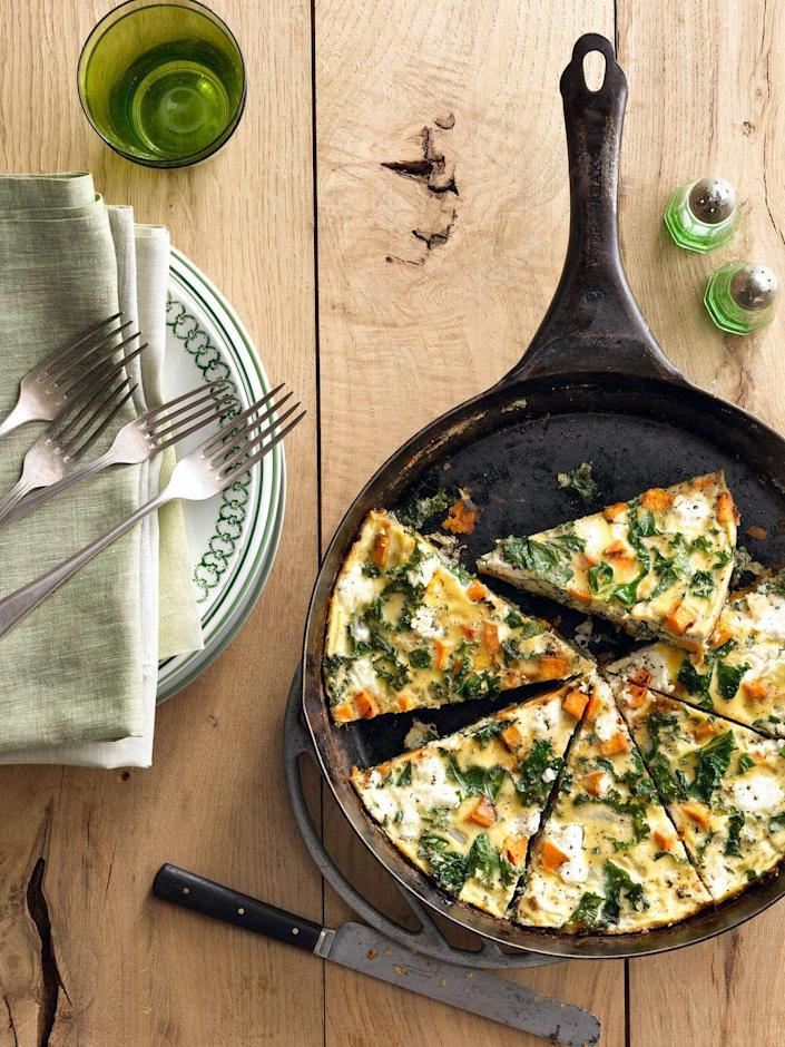 "<p>Serve breakfast for dinner one night this week. Sauté sweet potatoes and kale until tender, then add them to your egg mixture and sprinkle creamy goat cheese crumbles on top before baking. </p><p><em><a href=""https://www.womansday.com/food-recipes/food-drinks/recipes/a39769/sweet-potato-kale-frittata-recipe-clx0914/"" rel=""nofollow noopener"" target=""_blank"" data-ylk=""slk:Get the Sweet Potato Kale Frittata recipe."" class=""link rapid-noclick-resp"">Get the Sweet Potato Kale Frittata recipe.</a></em></p>"