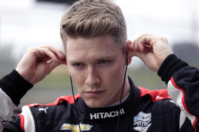 """FILE - In this Feb. 12, 2020, file photo, IndyCar driver Josef Newgarden prepares for IndyCar Series Open Testing, in Austin, Texas. The 2020 IndyCar season will open Saturday night, June 6, at Texas Motor Speedway. Texas is a very difficult racetrack to race in general, whether youve been there 20 years or first time. Its a daunting track to get right, Newgarden said. """"Typically we have five races or so to sort out our stuff, kind of get ourselves in the right frame of mind, have a general base before we go to a track like that."""" (AP Photo/Eric Gay, File)"""