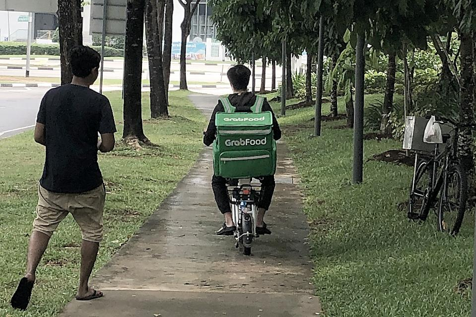 A GrabFood delivery rider on an e-scooter seen along Jurong East Street 21 on 5 November 2019. (PHOTO: Dhany Osman / Yahoo News Singapore)