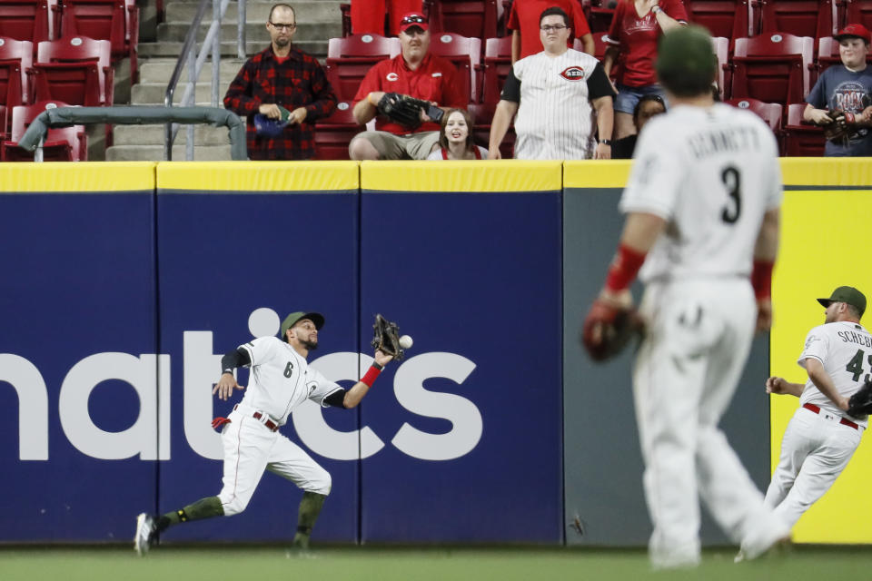 "A number of Reds players and <a class=""link rapid-noclick-resp"" href=""/mlb/players/7934/"" data-ylk=""slk:Carlos Gonzalez"">Carlos Gonzalez</a> forgot how to play baseball for one play. (AP)"